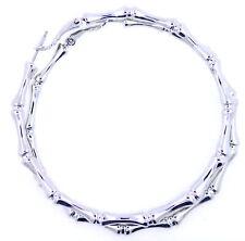 Connected silver bones, large and spooky hoop earrings. 65mm diameter. Halloween