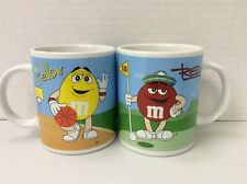 M&M's Coffee Mugs. Yellow, Green, Red, Blue in Sport Settings by Galerie 2002
