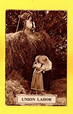UNION LABOR stacking hay lady on haystack watches lovers kiss not much work done