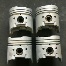 """FORD X-FLOW 1600 PISTON SET WITH NEW RINGS 711M6110 +.030"""" GENUINE FORD / AE"""