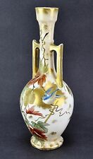 A ROYAL WORCESTER TWO HANDLED VASE decorated with a humming bird. (BI#MK/170525)