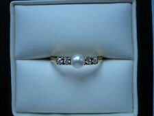 18ct yellow gold cultured pearl and diamond ring. Size O.