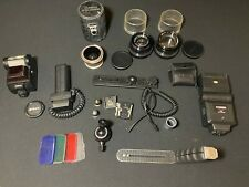 A Job Lot Collection of Camera Lenses and Accessories - Nikon, Cobra, Fujinon