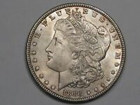AU+ 1885 Silver US Morgan Dollar (Toning).  #79
