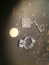set of two keyholders (big ring with plastic stone, one from american indian chi