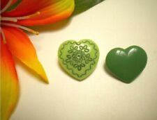 2 VINTAGE OPAQUE GREEN GLASS REALISTIC HEART GOOFIE BUTTONS WITH FOLK ART DESIGN