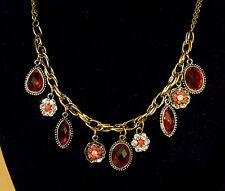 Bronskleurige dubbele ketting met rode stenen en bloem strass