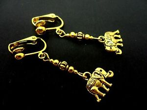 A PAIR GOLD COLOUR DANGLY  CLIP ON ELEPHANT EARRINGS. NEW.