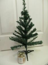 Small green table top artificial Christmas tree 60cm high with 12 gold baubles