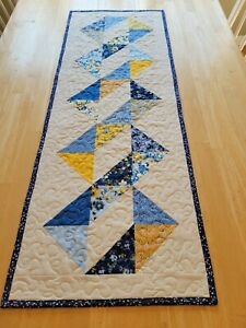 Handmade quilted table runner blues and yellows on cream