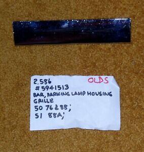 1950-51 Oldsmobile 76 & 88 Parking Lamp Housing Grille Bar NOS 5941513