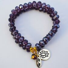 Double stranded purple crystal gold stretch bracelet with Lotus Flower charm