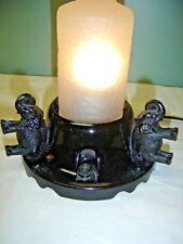 Black Glass Elephant Lamp. Scalloped base.three elephants  in a circle 6959