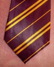 HARRY POTTER MAROON STRIPED NECK TIE WITH HARRY POTTER LABEL DATED c) APRIL 15