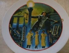 SINGIN' IN THE RAIN COLLECTIBLE PLATE BY AVON & Musical Plate Stand