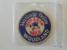 Milk bottle Cap advertising Hartwig Dairy Woodland Cow Head Logo vtg
