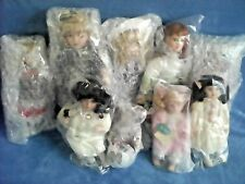 Lot Of 9 Pre-Packaged Porcelain Dolls; See Additional Pictures For Review