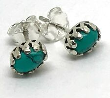 Turquoise oval stud earrings, fancy crown setting, 7 x 5mm, UK. Reconstituted.