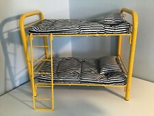 American girl yellow bunk bed. Includes clean bedding. Good condition