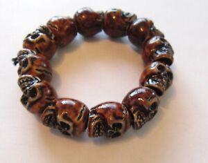 Fashion Stretch Bracelet -SKULLS- brown ceramic beads