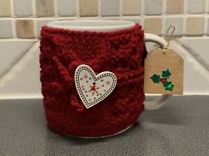 Hand Knitted Red Christmas Mug Cosy With Pretty Snowflake Heart Button