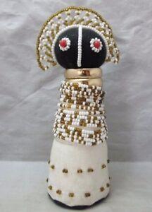 Beaded folk art doll