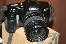 Minolta Dynax 3000i 35 mm SLR Film Camera +35-80 mm AF LENS + programma D 314i flash.