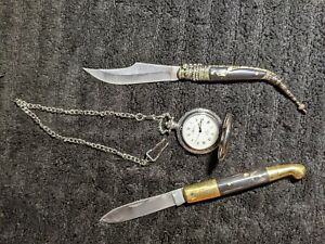Two folding knives and one Reliance pocket watch that keeps perfect time.