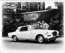 1963 Studebaker Hawk GT in front of brick building, Factory Photo (Ref. #91839)