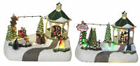2-Pc Lighted Christmas Snow Village Holiday Moving Scene Gazebo Figurine Set