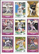 Mark McGwire plus 8 more A's baseball card lot.