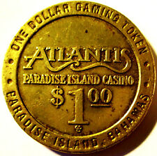 ATLANTIS .PARADISE  ISLAND CASINO .ONE DOLLAR GAMING TOKEN .3.7 CM X 2.5 MM