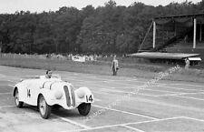BMW 328 B Bira sat in car in pits. Photo at  RAC Tourist Trophy Donington 1938.