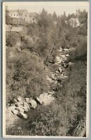 RPPC Postcard Nevada City CA Deer Creek and the back of buildings Unposted