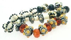 OliveStuart Handmade Lampwork Beads 31 black/amber/brown/cream round/barrel