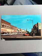 vintage postcard 1900s Devils Lake  ND Fourth Street View Downtown Signs