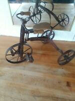 Vintage Metal Tricycle with wooden handlebars and seat.