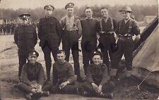 WW1 Soldier Group Rifle Brigade in tented camp  one wears steel helmet