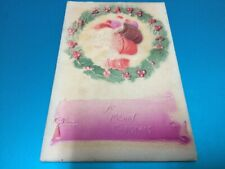 1900'S Postcard A Merry Christmas Embossed Colored Santa, Wreath, Toy Bag