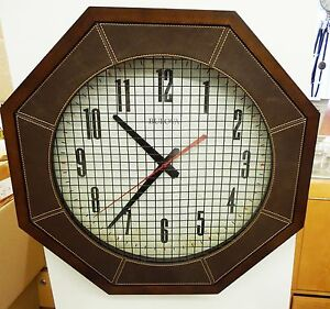 "WALL CLOCK 18 "" DIAMETER -""THE GYMNASIUM""  MADE BY THE BULOVA CLOCK CO. C4376"