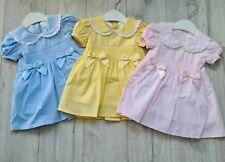 Little Nosh Spanish double bow dress / smocked detail pink/lemon/blue 0-3 years
