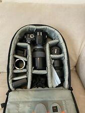Nikon D5100 Camera w/4 Lenses, Lens Filters, Batteries And Charger In Bag