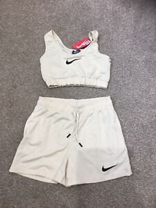 LADIES NEW NIKE TOP AND SHORTS WHICH HAVE BEEN WORN  ONCE SIZE Upto 12 Poss 14