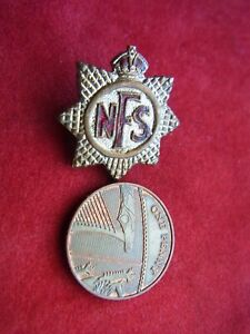 A VINTAGE ENAMEL PIN BADGE 'N.F.S.' NATIONAL FIRE SERVICE