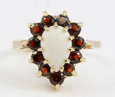 10k Yellow Gold Prong Set Pear Shape Opal & Red Round Garnet Halo Ring Band