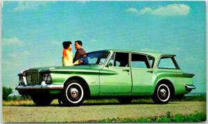 1960 PLYMOUTH VALIANT V-100 Suburban Postcard Blue Station Wagon Advertising NY