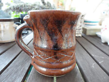 STUDIO POTTERY MUG BROWN FANCY HANDLE. MARKED JR INCISED.9.5 CM TALL.VERY GOOD
