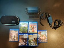 Sony PlayStation Vita Black Handheld System + 6 Games + DreamGear Carry Case