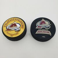 2 Colorado Avalanche Official NHL Hockey Gold Puck / Pucks - See Notes