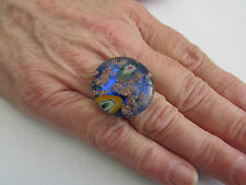 A BLUE MILLIFIORE ADJUSTABLE LAMPWORK GLASS RING.    (7)